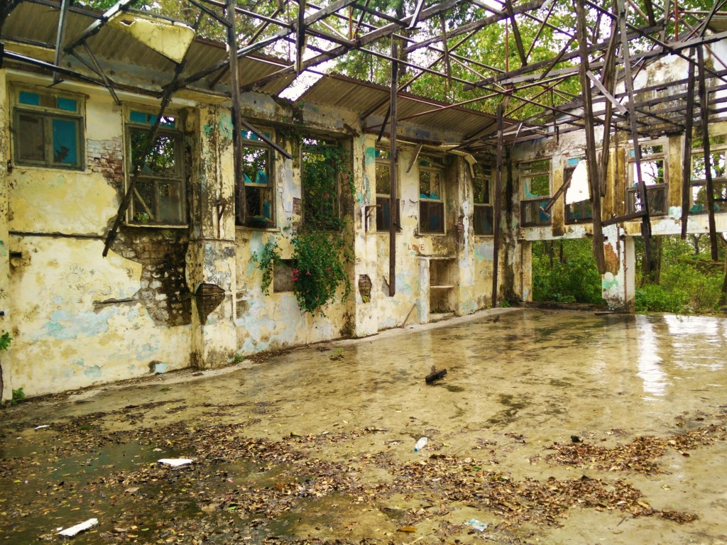 Crumbling and eroding ashram hall